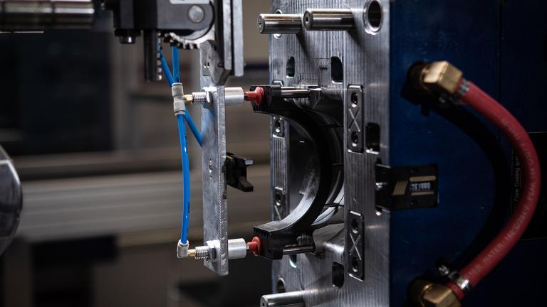 Linear Plastics detailed photo of Auto De-moulding machinery