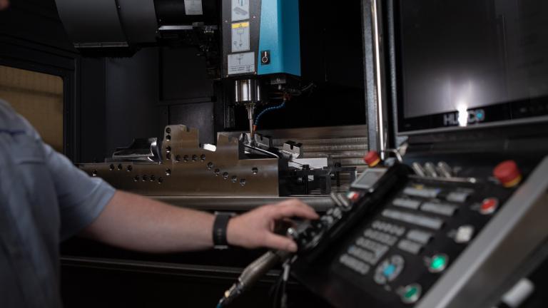 Employee working on Linear Plastics Capacity CNC machining centre