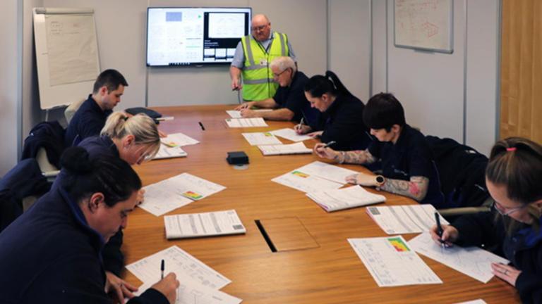 Linear Plastics staff in training room